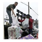 Supply Department unload packages donated to the Christmas Angels gift drive