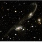 Two Galaxies Distorted by an Ongoing Interaction (ESO 69-6, ESO 069-IG006, AM 1633-682)