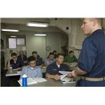 800px-US Navy 070809-N-5387K-003 he Ship's Psychologist, Lt. Justin D'Arienzo teaches a psychology class aboard the USS Kitty Hawk (CV 63)