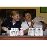 800px-US Navy 090527-N-7415V-003 Hospital Corpsman 2nd Class Katherine Bishop watches pharmacist Teresa Balcos prepare medication for a medical mission at Bang Bang Elementary School