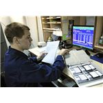 800px-US Navy 110129-N-7676W-152 Culinary Specialist 3rd Class John Smith uses the existing DOS-based food service management system aboard the aircraft