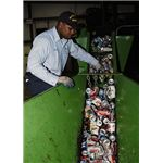 428px-US Navy 050531-N-9293K-003 Fireman Brian Wilson of Charleston, S.C., separates bottles from aluminum cans at the Navy Recycling Center on board Naval Station Everett, Wash