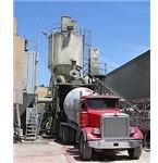Loading a concrete truck mixer