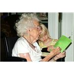 Reading with grandmother in wheelchair