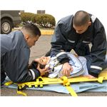 Hospital Corpsman Fernando Prieto and Hospital Corpsman Raulito Galgana demonstrate life saving techniques in the parking lot outside the Emergency Room of U.S. Naval Hospital Yokosuka, Japan