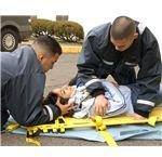 Hospital Corpsman Fernando Prieto and Hospital Corpsman Raulito Galgana demonstrate life saving techniques in the parking lot outside the Emergency Room of U.S. Naval Hospital Yokosuka, Japan