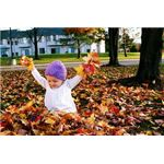 Toddler playing out leaves
