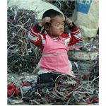 A Chinese Child Surrounded by e-waste