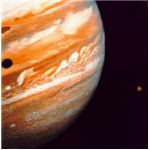 Jupiter with Io (right) and Ganymede shadow
