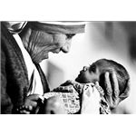 Mother Teresa cradling an armless baby orphan