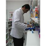 Ancillary personal at work in a drugstore by Penarc/Wikimedia Commons