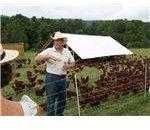 800px-Joel Salatin in front of hens