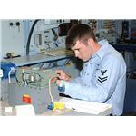 800px-US Navy 030618-N-3970R-011 Aviation Electronic Technician 2nd Class Luke Rachel repairs a field amplifier