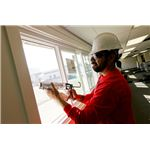 800px-US Navy 100809-N-8863V-043 A construction worker installs new energy-efficient windows in Bldg. 519 at Naval Surface Warfare Center