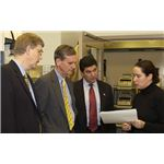 800px-Sen. Gregg Visits Lab Dr. Francis Collins, director of NHGRI