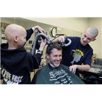 800px-US Navy 110326-N-3542S-003 A current and former patient of the pediatric oncology ward at Naval Medical Center Portsmouth shave the head of Capt. T