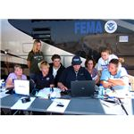 800px-FEMA - 30523 - New FEMA workers looking at a computer screen in Kansas