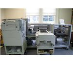 On-demand book printer by Dvortygirl/Wikimedia Commons