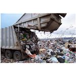 Garbage Truck Dumping Waste in a Landfill