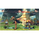 Street Fighter 4 characters Chun-Li and Ryu mid-fight