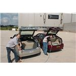 800px-Plugging in Argonne hybrid electric vehicles
