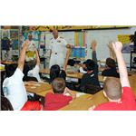 800px-US Navy 090320-N-3666S-147 Capt. Ricks Polk, commanding officer of Afloat Training Group Middle Pacific answers questions from students during a Career Day at Iroquois Point Elementary School