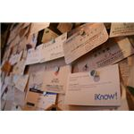 A wall of Japanese business cards (meishi).