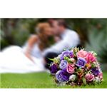 767500 beautiful bouquet with groom and bride at back