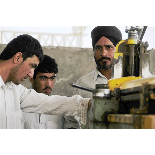 800px-Factory workers in Herat