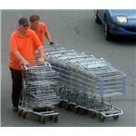 690px-Supermarket employees clearing up shopping carts
