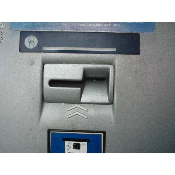 ATM Skimming Device. Notice the arrow is too near