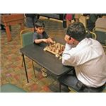Playing chess is fun for young and old