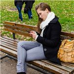 Woman using smartphone in park