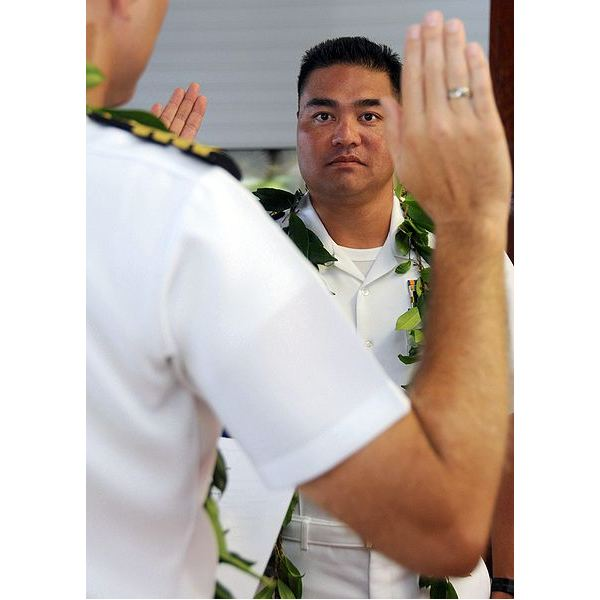 Native Hawaiian Cmdr. Mel Yokoyama, executive officer of Cruise Missile Support Activity, Pacific, listens to the oath of appointment during his promotion ceremony at the U.S. Pacific Fleet boathouse