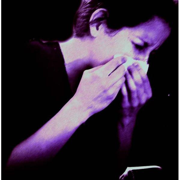 591px-Woman sneezing