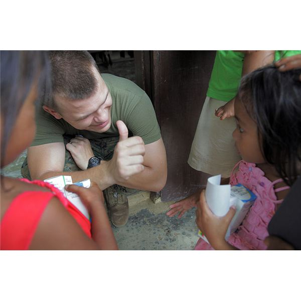r Juchniewicz, gives a thumbs up while handing out medication during a medical civic action project supporting Balikatan 2009 at Nakar Elementary School