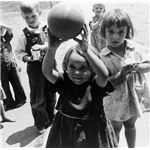 611px-Dorothea Lange, Migrant children playing at nursery school, FSA camp, Tulare County, California, 1939