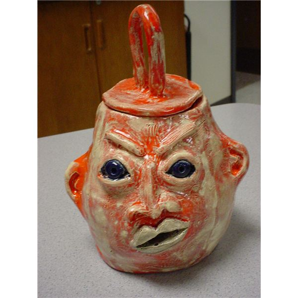 Use Coil Building with Clay to Make Coil Face Jugs in High School Art