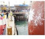 champagne hitting ship's hull