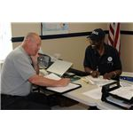 800px-FEMA - 40945 - Security Manager with Brantley Co.DRC Manager