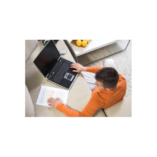 Online student using laptop to access virtual classroom.