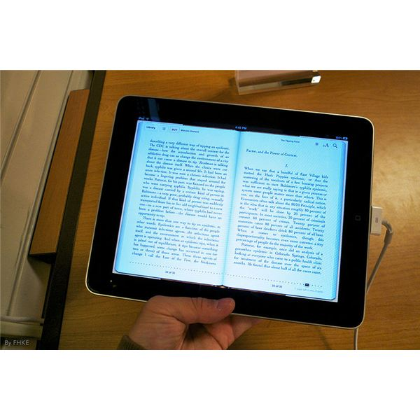 reading a book on the IPad - Wikipedia image by mewtu