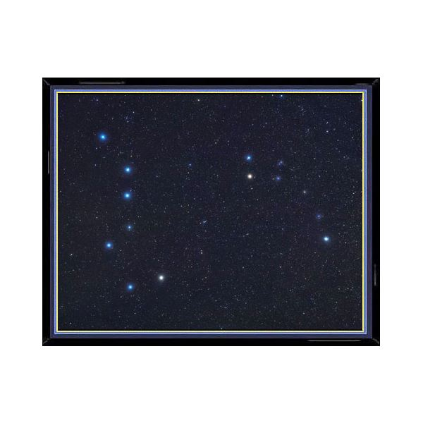 This photo of the constellation Ursa Minor shows, enlarged in their true color, the main