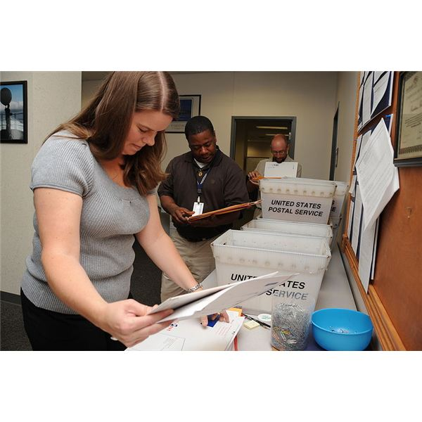 800px-US Navy 100518-N-0659H-002 Shaunna Brooks, left, Anthony Anderson and Jim Murray, customer service center agents, sort through selection board packages at Navy Personnel Command