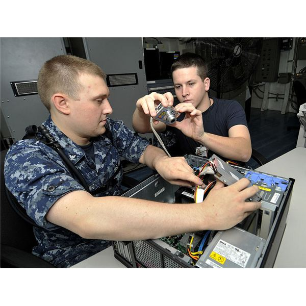 793px-US Navy 100626-N-6003P-040 Information Systems Technicians 3rd Class Travis Golding and Michael Wentz take photographs for a manual on how to assemble computer towers