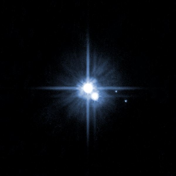 Pluto, Former Planet, with Three Moons