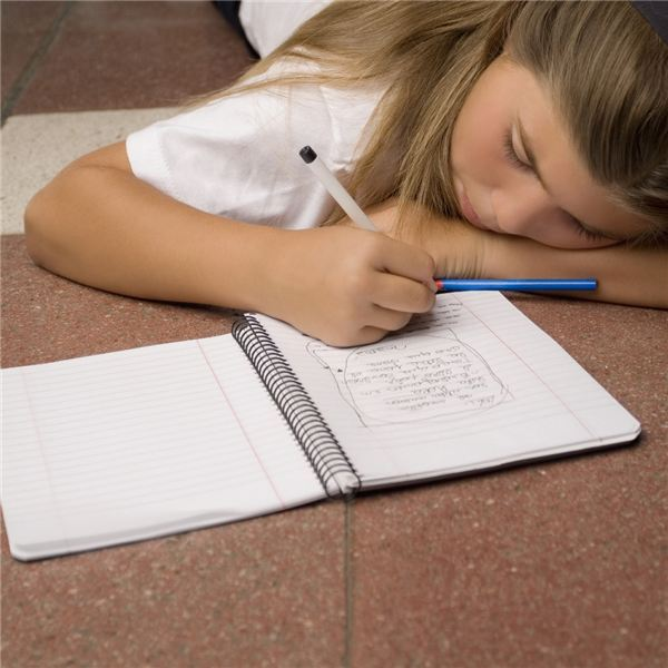 Girl writing in a spiral notebook
