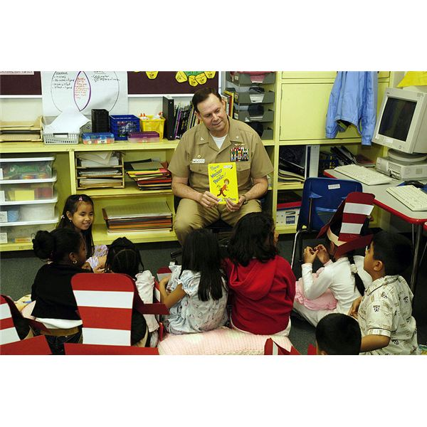 Naval Officer reading Dr. Seuss to elementary school students. Links to download Dr Seuss fonts included in article.