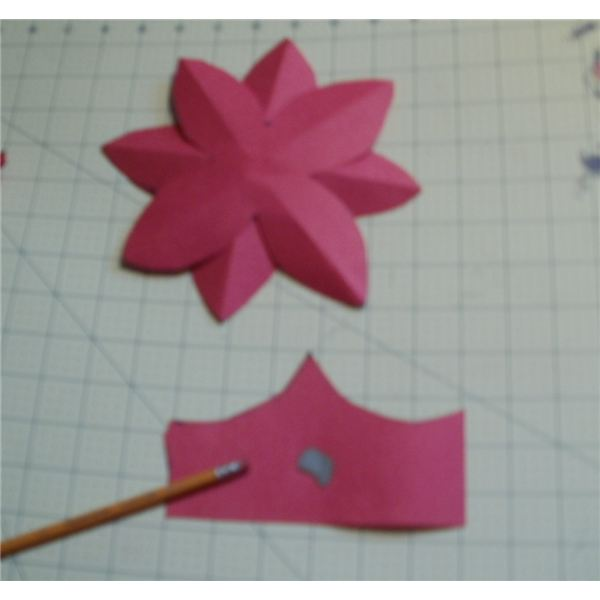 put a dab on paint on a scrap of paper and use the end of a pencil eraser to put dots in the center of the flower