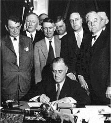 Roosevelt Signs a Document as Part of the WPA